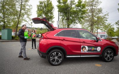 Josee Desjardins, Breakfast Club of Canada and Alan Lyddiatt, Mitsubishi Motors Canada load up a Mitsubishi Eclipse Cross, the company's Community Utility Vehicle, for delivery to children and families in the community. Mitsubishi Motors Canada has donated $50,000 to the charity's Emergency COVID-19 Club Fund and CUVs in Vancouver, Toronto and Montreal to be used for food delivery and logistics while school is out due to COVID-19. During the pandemic the charity has expanded its mandate increasing logistics needs such as transportation and funding as the crisis has had a severe financial impact on many families.